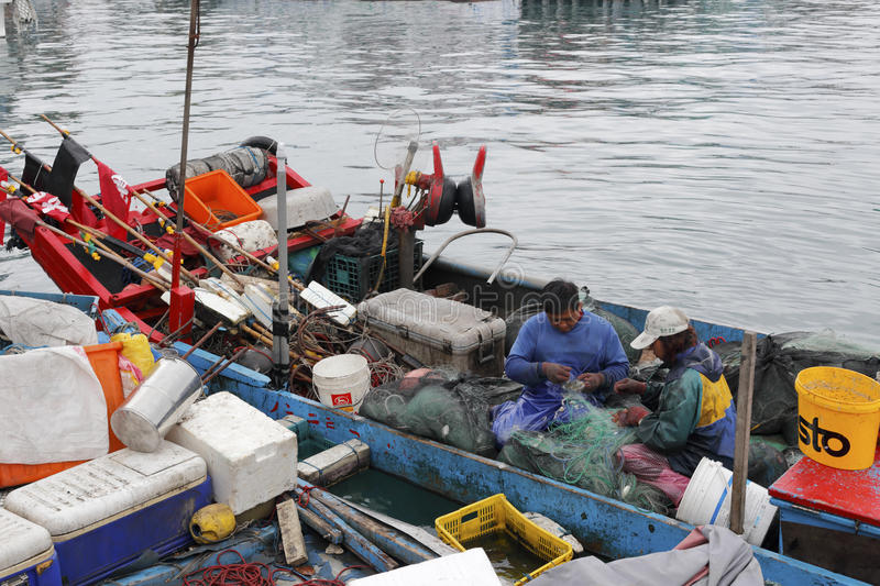 Small fishboat at ferry of yilan county, taiwan. In the morning, fishermen couple finishing seafood caught back, live self-sufficient lives, enviable. they were stock image