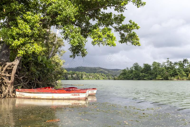 A small fisher boat on a river, Cuba stock photography