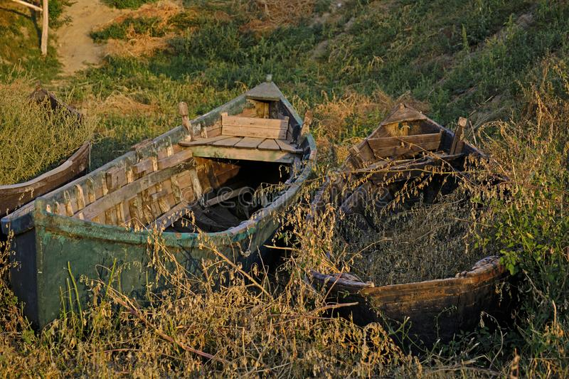 A small fishermen`s harbor. On the Razelm Lake, near the Danube Delta, Sarichioi is a small fishermen`s harbour very beautifull in the morning light. Old boats royalty free stock photos