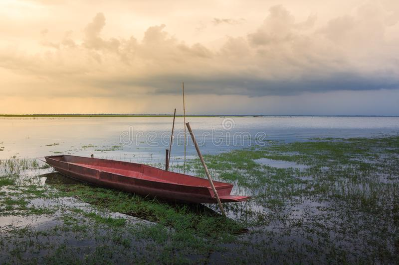 a small fishing boat on the dam royalty free stock photo