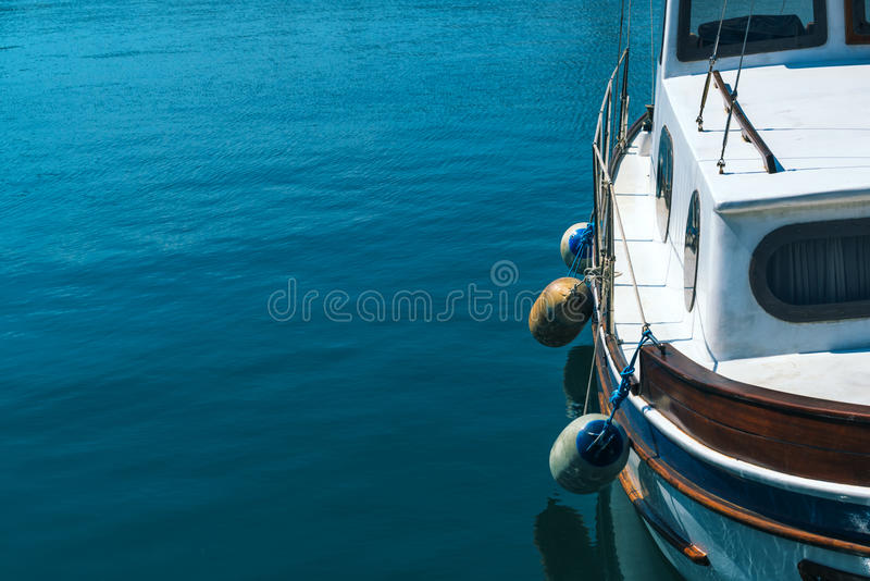 Small fishing boat in harbor stock photo