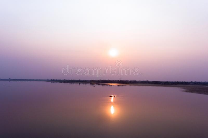 Small fishing boat in larg dam. And river with sunset royalty free stock images