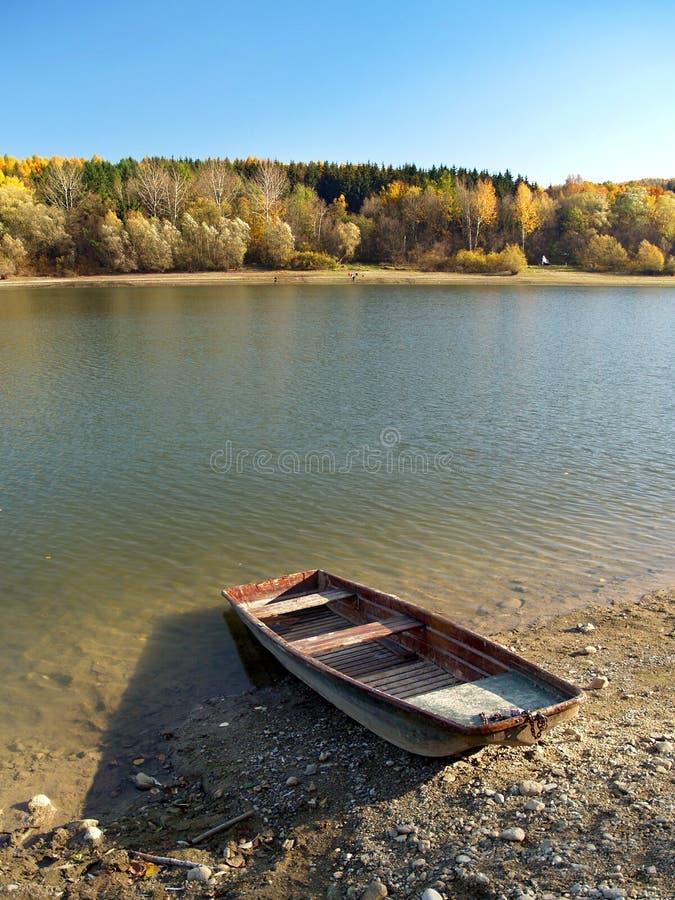 Small fishing boat at Liptovska Mara, Slovakia royalty free stock photos