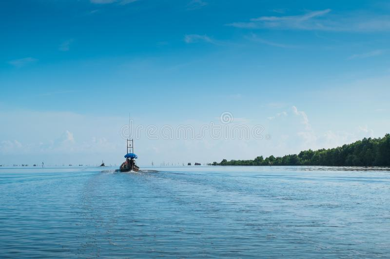 A small fishing boat is out in the morning in the beautiful sea. royalty free stock photo