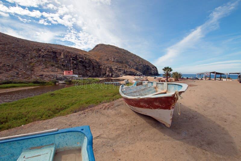 Small fishing boat / ponga at Punta Lobos beach on the coast of Baja California Mexico. BCS stock photo