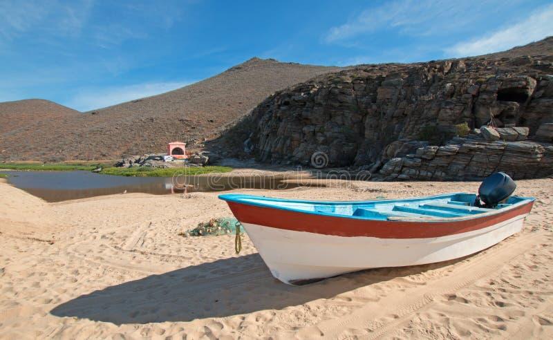 Small fishing boat / ponga at Punta Lobos beach on the coast of Baja California Mexico. BCS royalty free stock photo