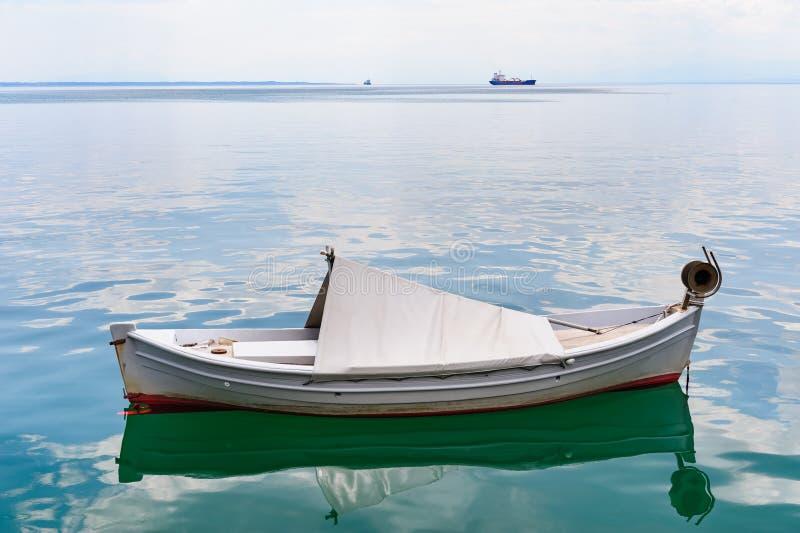 Small fishing boat at sea surface royalty free stock images