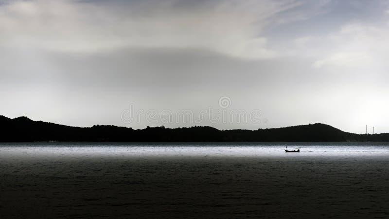 Small fishing boat at sea. View stock image