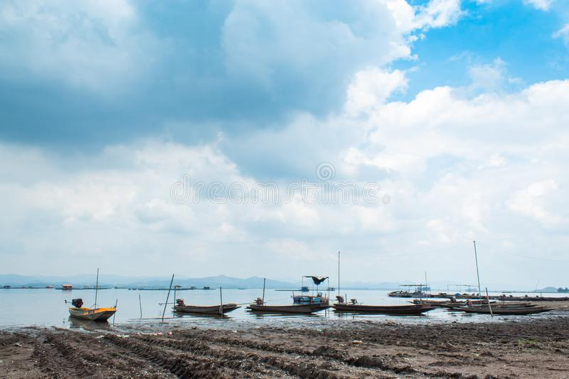 Small fishing boats in dam. In Thailand stock image