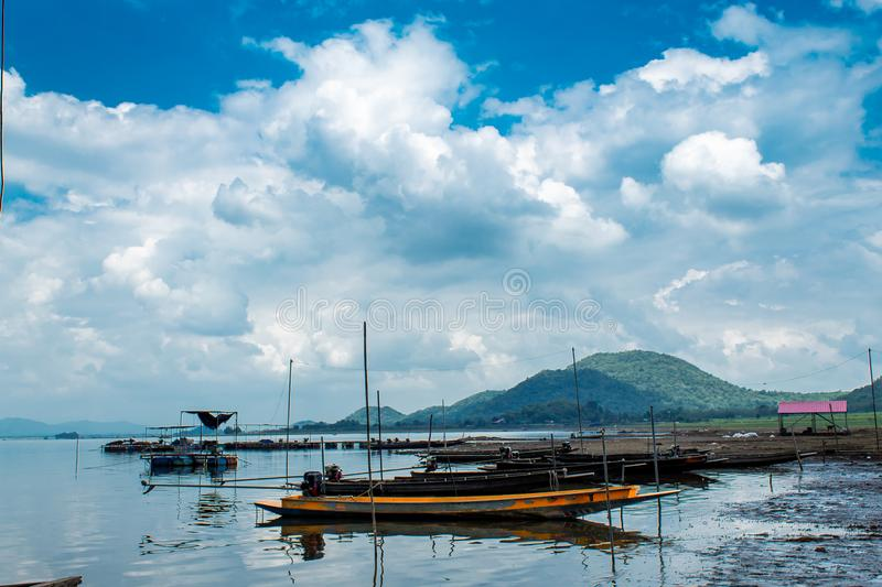 Small fishing boats in dam. In Thailand stock photo