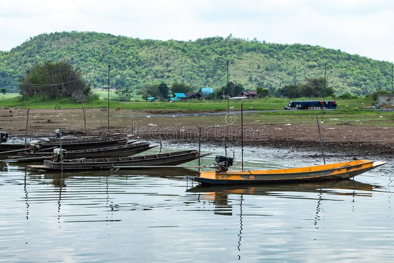 Small fishing boats in dam. In Thailand stock photography