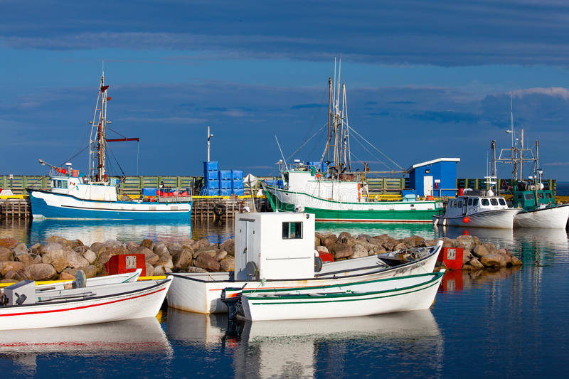 Small Fishing Boats Lanse Amour Labrador Canada. Colorful small fishing boats in harbor of L`anse Amour, Labrador, NL, Canada stock image