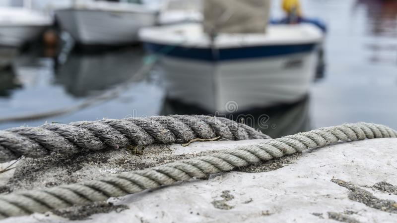Small fishing boats moored in port stock photo