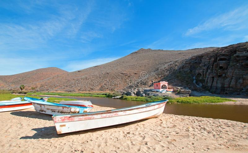 Small fishing boats / pongas at Punta Lobos beach on the coast of Baja California Mexico. BCS royalty free stock photo