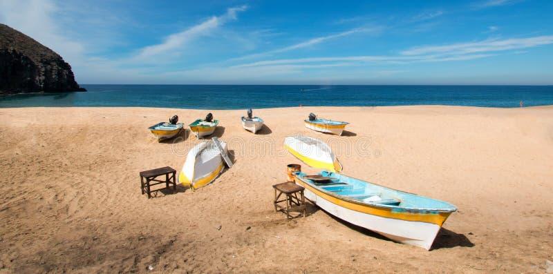 Small fishing boats / pongas at Punta Lobos beach on the coast of Baja California Mexico. BCS royalty free stock images