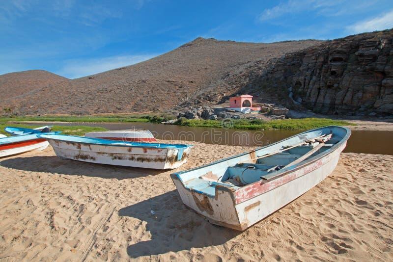 Small fishing boats / pongas at Punta Lobos beach on the coast of Baja California Mexico. BCS stock images