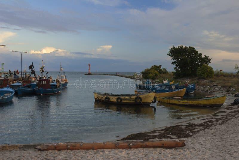 Small fishing port. At dusk, fishing boats royalty free stock photo