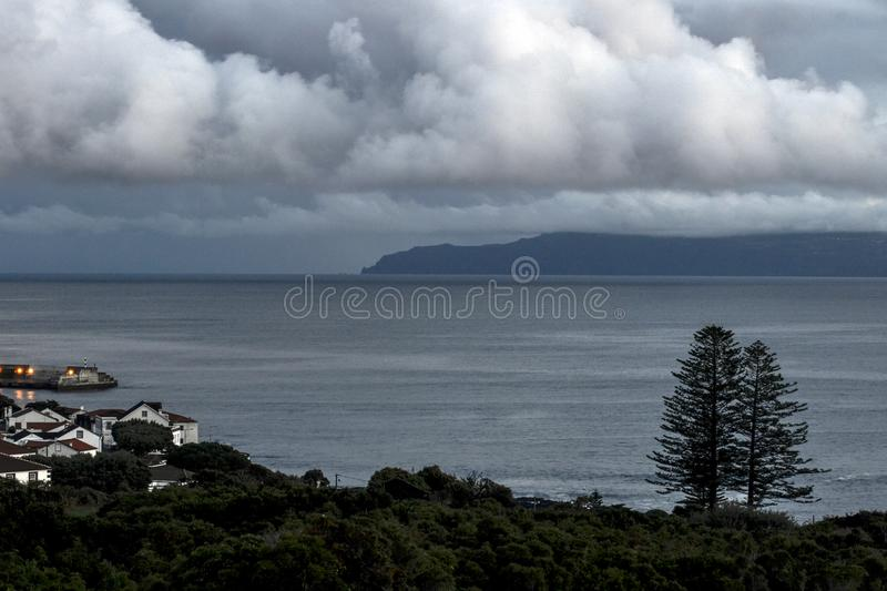 Download A Small Fishing Village On The Coast Of Pico After Sunset Stock Photo - Image of coast, small: 104856170