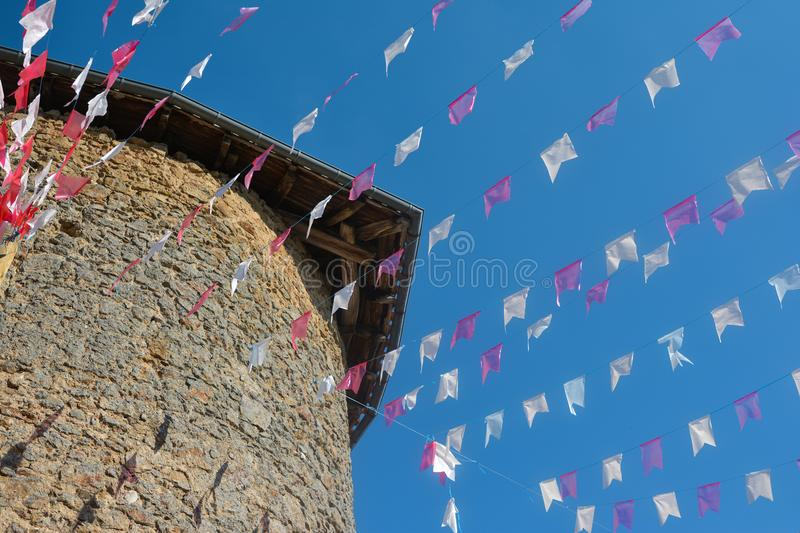 Small flags stretched on a rope. On a sky background royalty free stock images