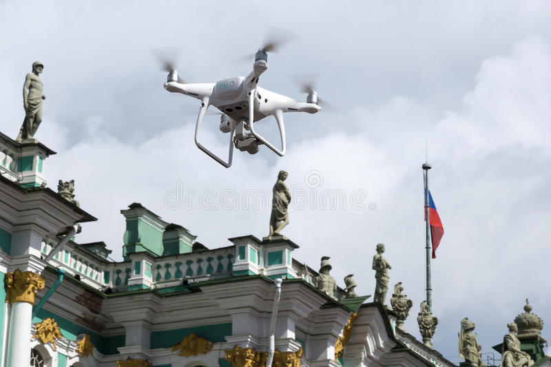 A small flying machine for photoshooting in the sky over the Palace Square in St. Petersburg stock images