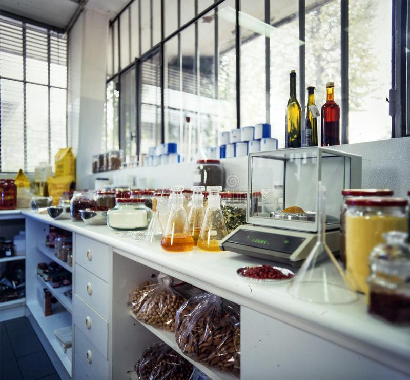 Small food laboratory. Interior of small food lab with electronic balance and glasses royalty free stock images