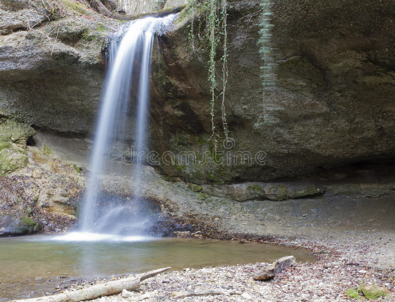 Small forest waterfall stock photo
