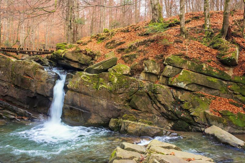 Small forest waterfall in autumn royalty free stock photos