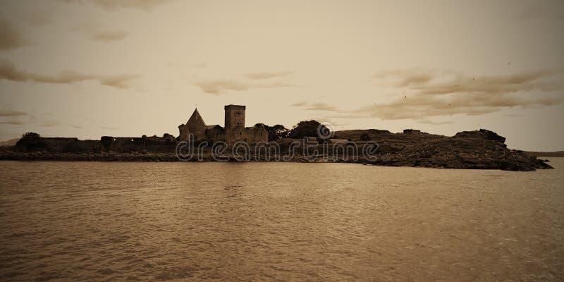Small fort on an island near Forth Bridge, Edinburgh, North Sea, Scotland royalty free stock photo