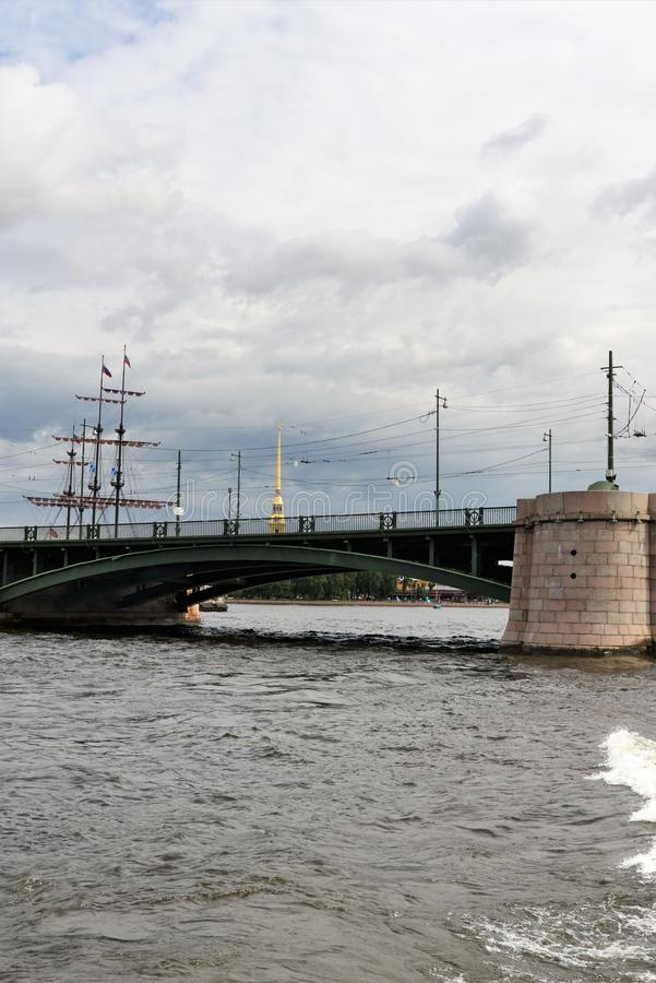 St. Petersburg, Russia, July 2019. Fragment of the Palace Bridge on the background of a cloudy sky. stock image
