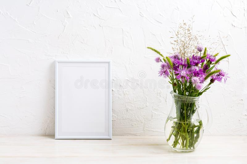 Small frame mockup with burdock flowers royalty free stock image
