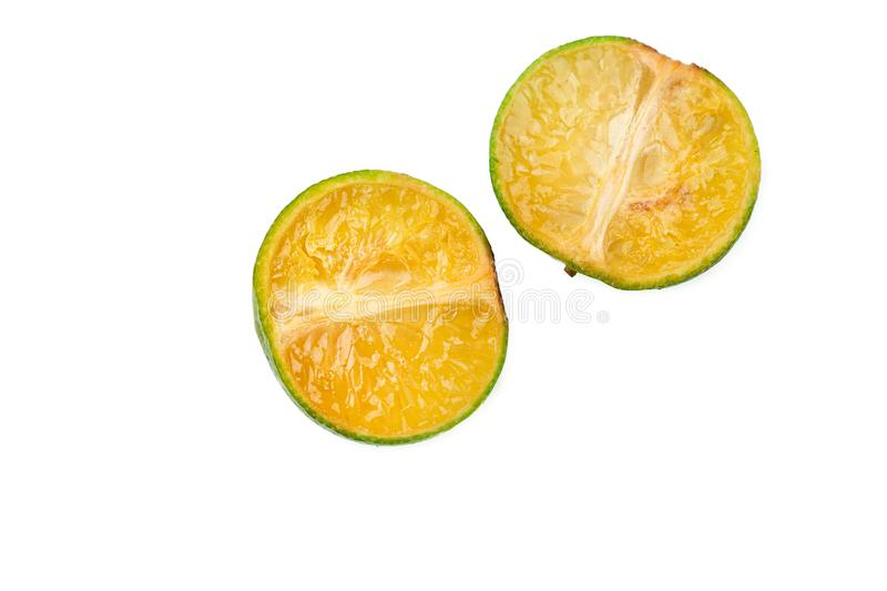 Small Fresh green oranges, on a white background. Cut Green tangerines. Tropical fruits collection. Cut Small Green tangerines. Fresh green oranges, on a white stock photography