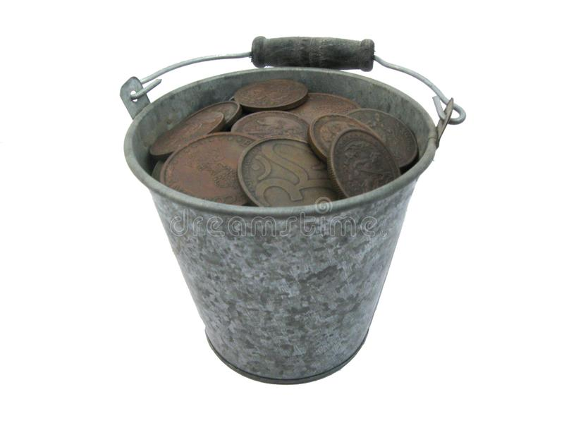 Small metal pail with old indian coins. Small full metal pail with old indian coins isolated on white background stock photography