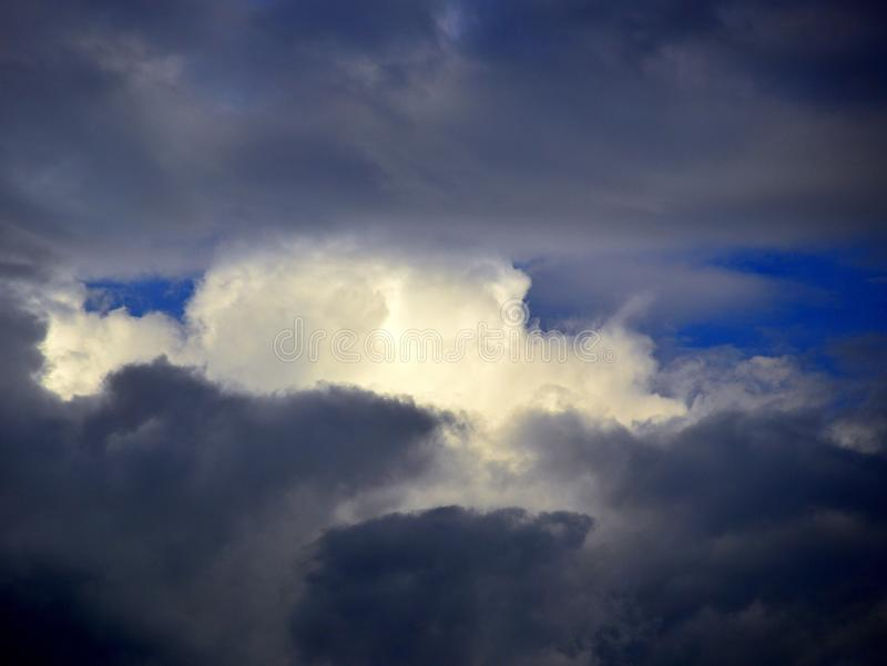 Dark Storm Clouds With Blue Sky and White Cloud in Gap royalty free stock images
