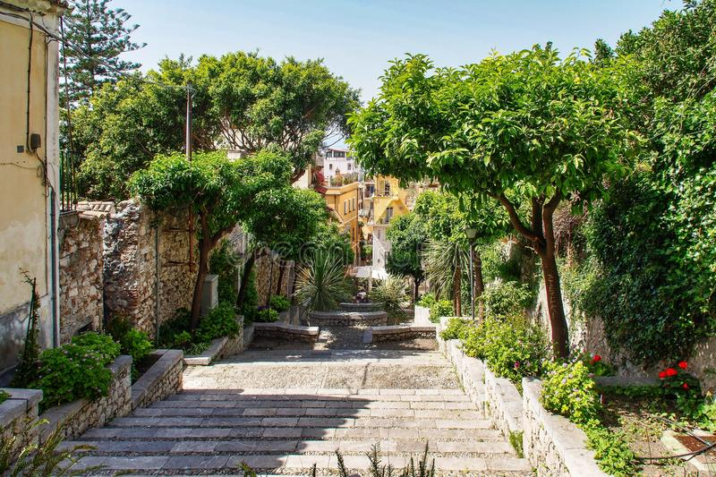 Small garden in the courtyard of a house in Taormina, Sicily in Italy. royalty free stock images