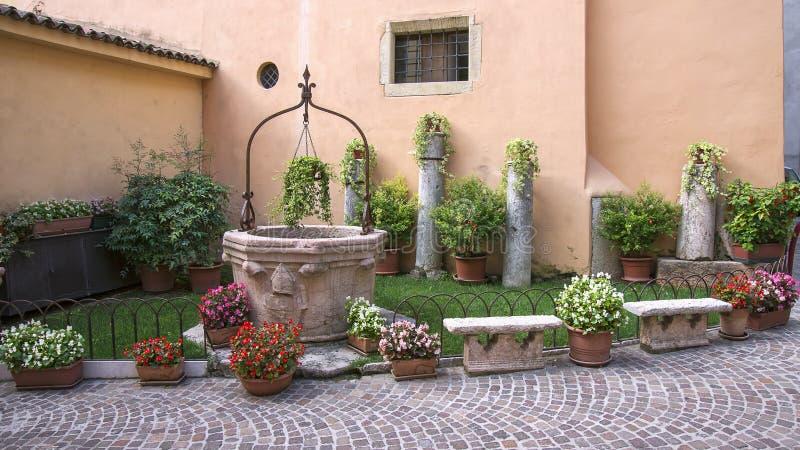 Small garden at the house wall. In Verona, Italy royalty free stock photo