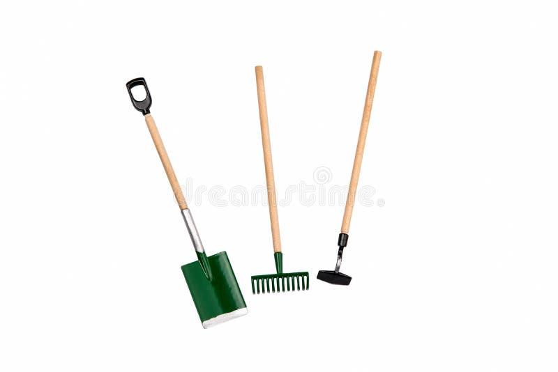 Small gardening rake, hoe and shovel isolated on white stock images