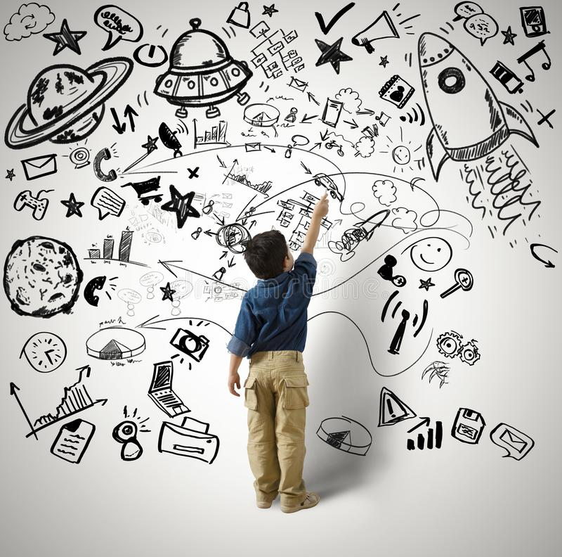 Small genius. Concept of small genius with kid and varius drawings stock photo