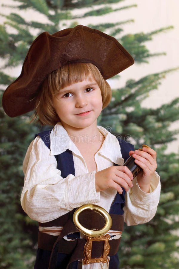 The small gentleman of fortune. With spyglass against xmas tree royalty free stock photos