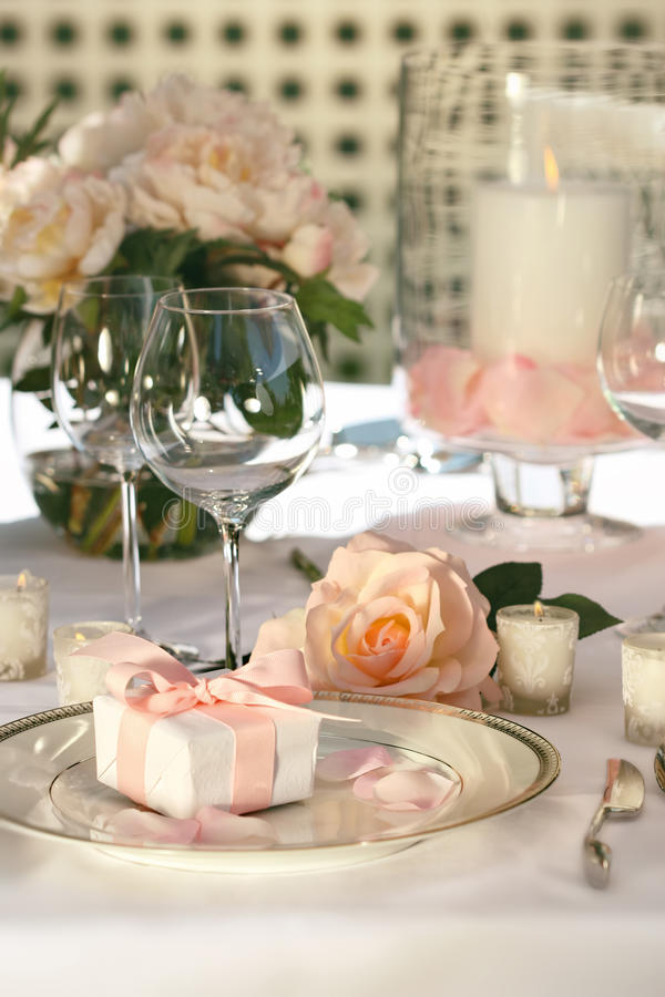 Small gift on plate at wedding. Reception stock photography