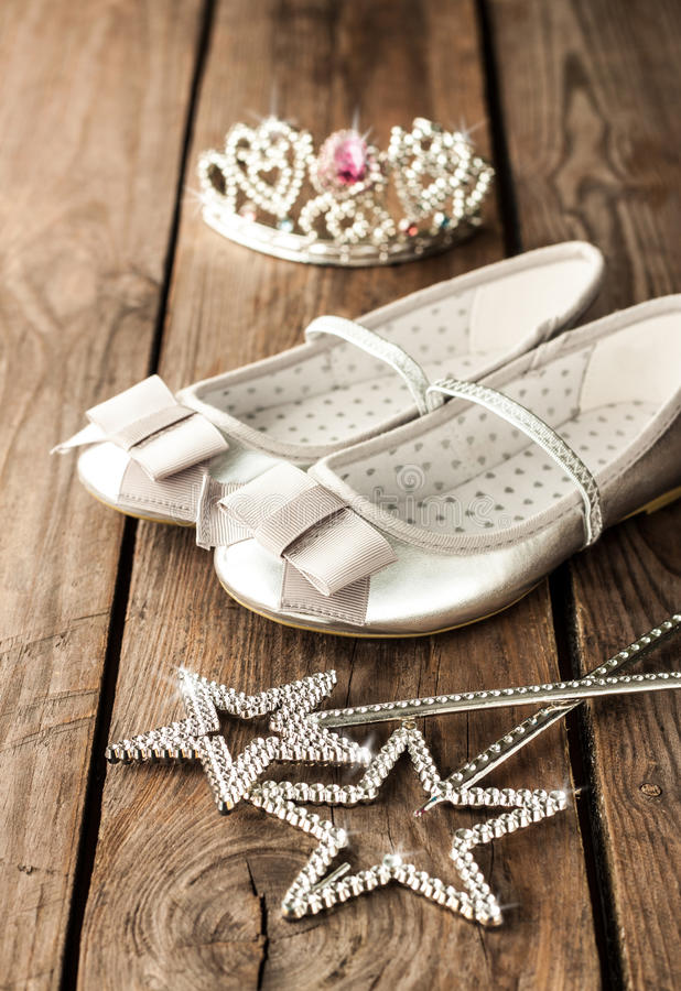 Small girl ball or party outfit with silver ballet shoes stock photos