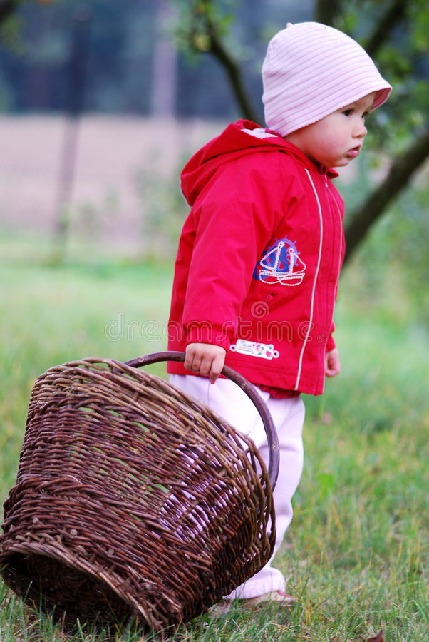 Small Girl And Basket Royalty Free Stock Photography
