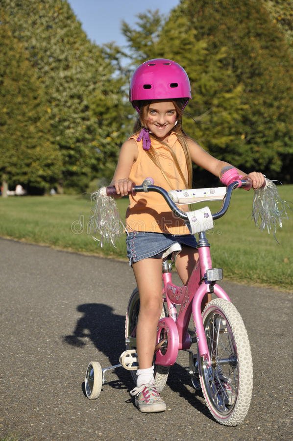 Download Small Girl On A Bike With Training Wheels Stock Image - Image of childhood, rural: 16389575