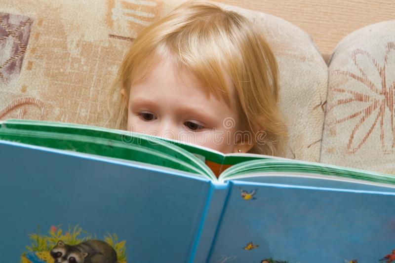 Small girl with the book royalty free stock image