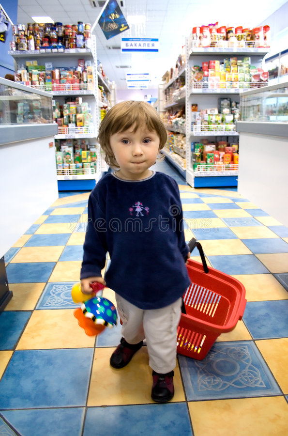 Small girl busy with shopping. royalty free stock images