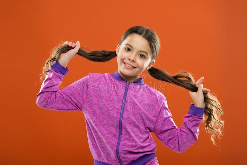 Small girl child. Hairdresser for kids. childrens day. Portrait of happy little child. Kid fashion and sportswear stock photo