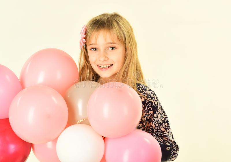 Small girl child with party balloons, celebration. Little girl with hairstyle hold balloons. Kid with balloons at stock photos