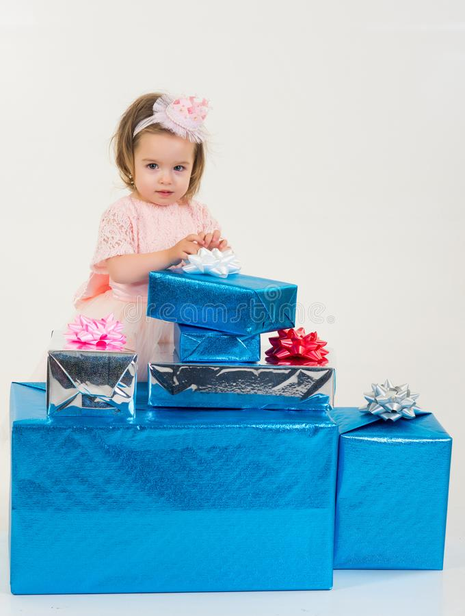 Small girl child with present box. Christmas gift. Thanks for your purchase. Happy birthday. New year party. happy royalty free stock image