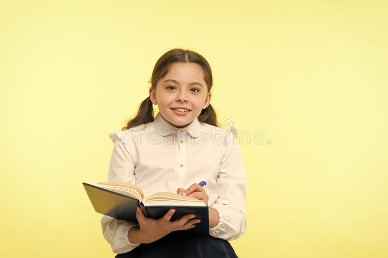 Small girl child. private teaching. happy little girl in school uniform. Smart school girl. childrens day. Back to royalty free stock photo