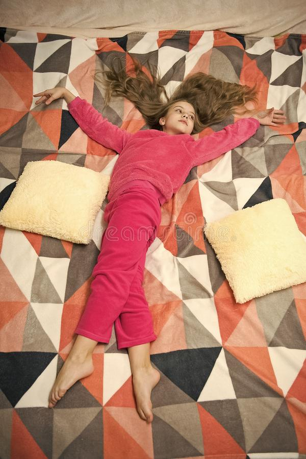 Small girl child ready to sleep. Time to relax. Childhood happiness. Little happy girl in bedroom. Pajama party. Good royalty free stock photography