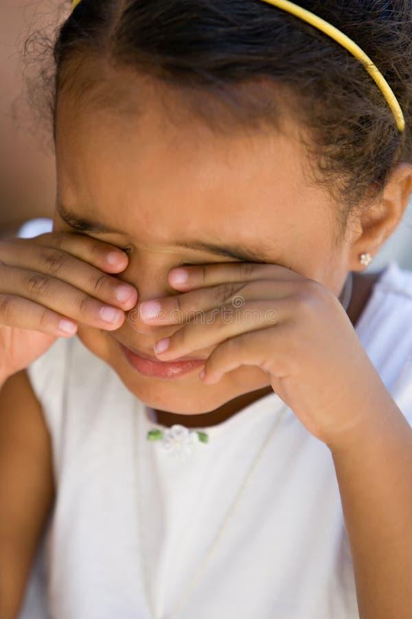 Small girl child rubbing eyes stock image